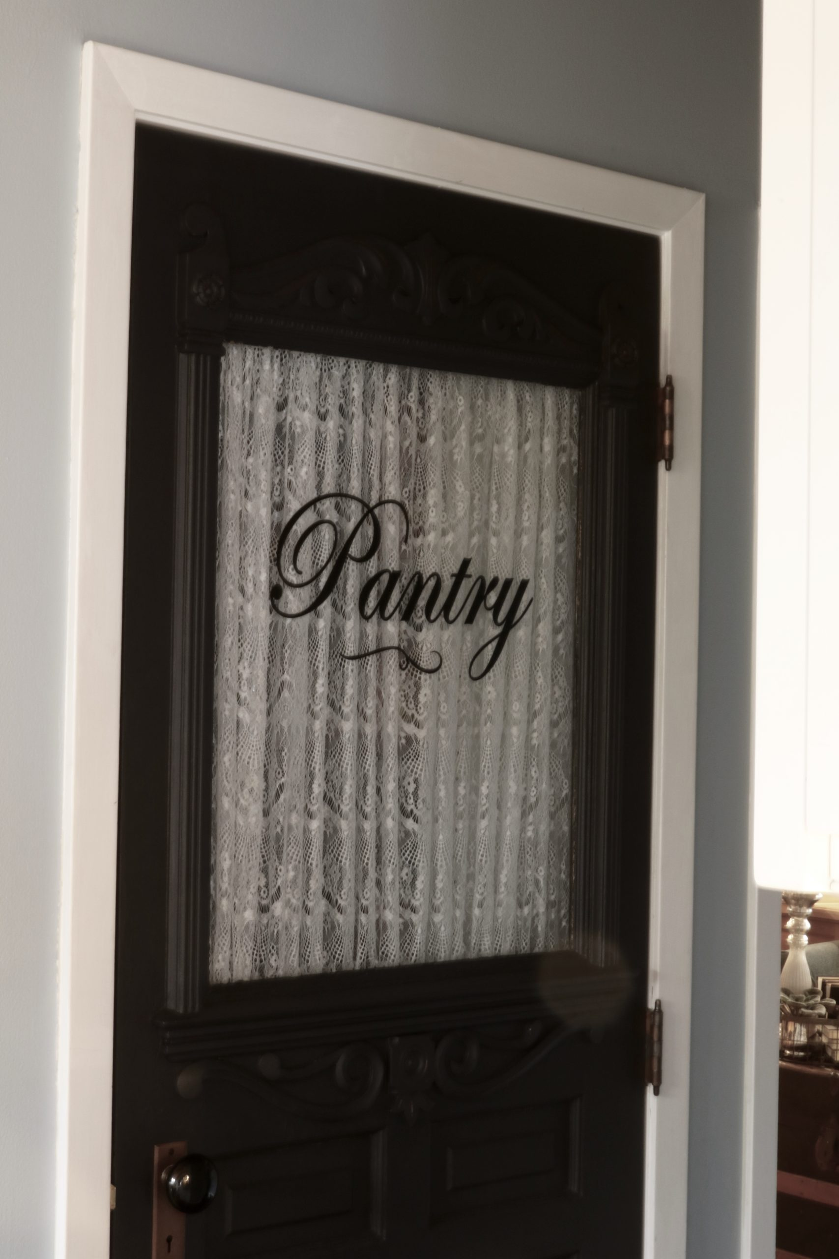 Antique Pantry Door on covered coat closet