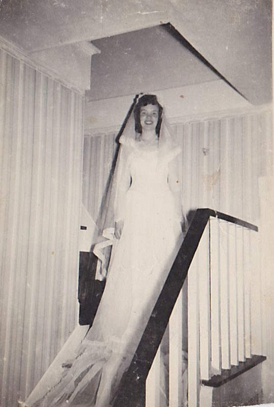 My Mom on the stairs in her parents farmhouse