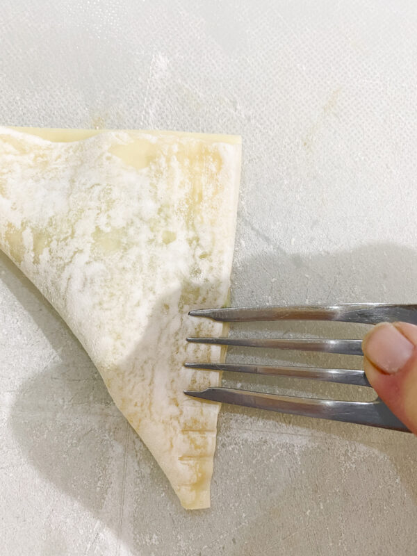 Fold the wrapper over and seal edges with a fork