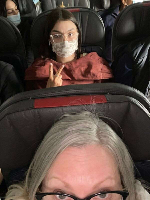 Emma sitting behind me in the airplane