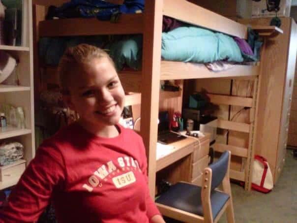Annie in her freshman college dorm room