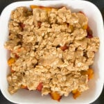Putting Peach Crumble together in baking pan