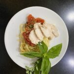 chicken breast with tomato basil sauce on pasta