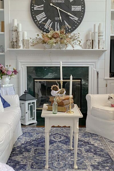 Farmhouse Living Room - White & Navy blue traditional rug with white sofa and chair flanking the fireplace made by my handy husband