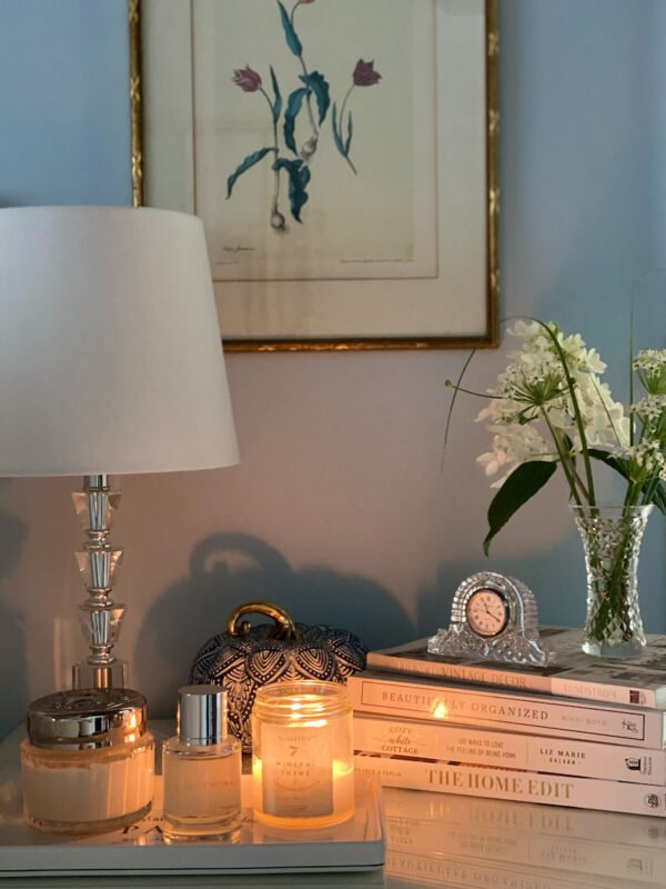 night stand in main bedroom with books and candle