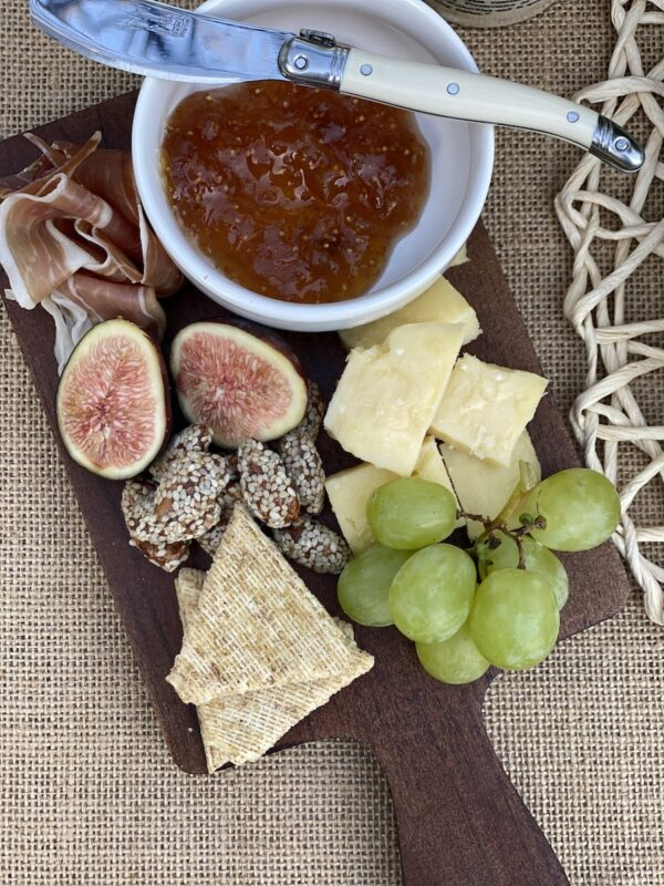 Individual charcuterie boards next to each place setting