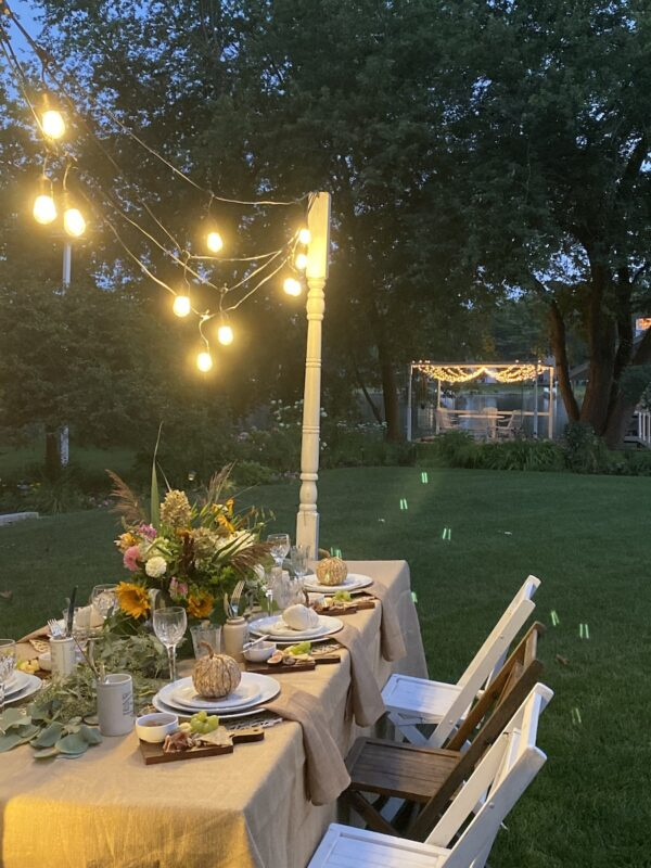 The harvest tablescape at night with the lighted dance floor from Annie's Wedding in the background